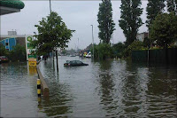 Ladas Drive flooded, via BBC