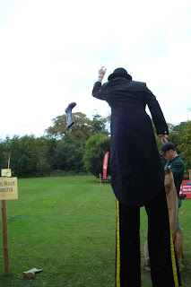 Stilt walker throwing a welly boot