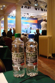A couple of bltles of Sinn Fein's branded water in the RDS Ard Fheis conference hall - Only Our Rivers Run Free states the label