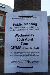 Notice on lamp post advertising public meeting about proposed closure of Belmont Post Office