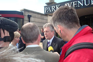 Peter Robinson talking to the press