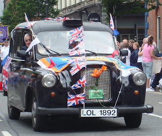 Taxi with false number plates in the Belfast parade