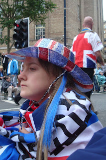 Young girl in bedford Street watching the Twelfth parade