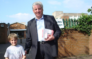 Alasdair McDonnell and his son Oisin outside St Bride's Primary School polling station in Derryvolgie Avenue, South Belfast