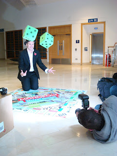 tossing dice to launch the Belfast edition of Monopoly