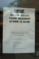 Photo of the closure notice on the door of the now-empty Faith store in Belfast's Victoria Square