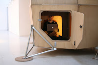Alec Farmer sitting inside his replica Ken Isaacs' micro home - Urban Nomad