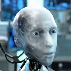 A photo of Sonny: He has a realistically shaped face and eyes, but his workings show through artificial skin.