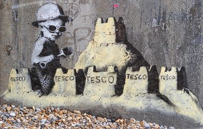 Banksy art: A child making Tesco sandcastles