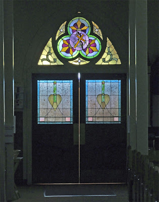 Immaculate Conception Catholic Church, in Columbia, Illinois, USA - Stained glass in the front door into the nave
