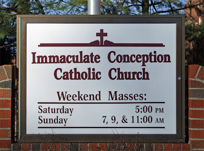 Immaculate Conception Catholic Church, in Columbia, Illinois, USA - sign with Mass times