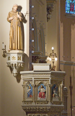 Saint Anthony of Padua Roman Catholic Church, in Saint Louis, Missouri, USA - pulpit and statue of Saint Francis of Assisi