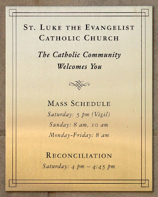 Saint Luke the Evangelist Church, in Richmond Heights, Missouri - sign with Mass times