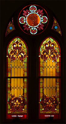 Saint Theodore Roman Catholic Church, in Flint Hill, Missouri, USA - golden stained glass window