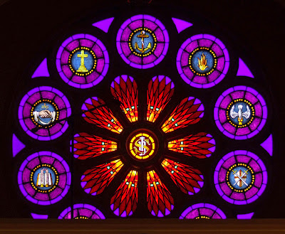 Saint Paul Roman Catholic Church, in Saint Paul, Missouri, USA -  Rose window above choir loft