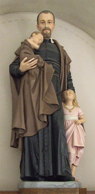 Saint Vincent de Paul Roman Catholic Church, in Dutzow, Missouri, USA - statue of Saint Vincent de Paul