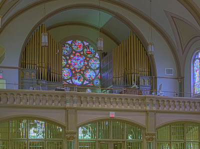 Saint Charles Borromeo Roman Catholic Church, in Saint Charles, Missouri, USA - Pipe organ and rose window in choir loft