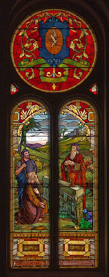 Saint Charles Borromeo Roman Catholic Church, in Saint Charles, Missouri, USA - stained glass window of Melchisedech