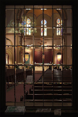 Saint Charles Borromeo Roman Catholic Church, in Saint Charles, Missouri, USA - nave through window in the narthex