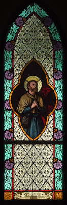 Immaculate Conception Roman Catholic Church, in Augusta, Missouri, USA -  Stained glass window of Saint Isidore, Farmer