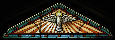 Immaculate Conception Roman Catholic Church, in Augusta, Missouri, USA - stained glass window of Holy Ghost as dove
