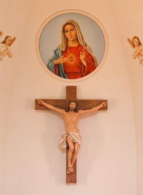 Immaculate Conception Roman Catholic Church, in Augusta, Missouri, USA - crucifix and painting of the Immaculate Heart of Mary