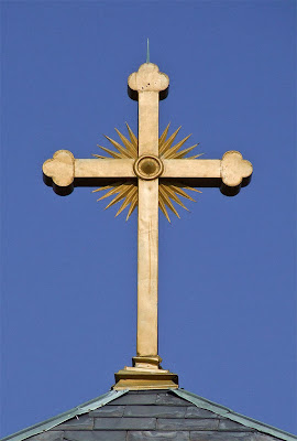 Holy Family Roman Catholic Church, in Port Hudson, Missouri, USA - golden cross on tower
