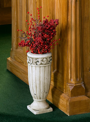 Saint James Roman Catholic Church, in Catawissa, Missouri, USA - red berries