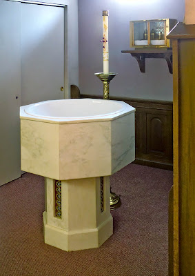 Sacred Heart Roman Catholic Church, in Crystal City, Missouri, USA - baptismal font