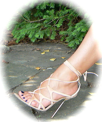 bare feet in high heel sandals