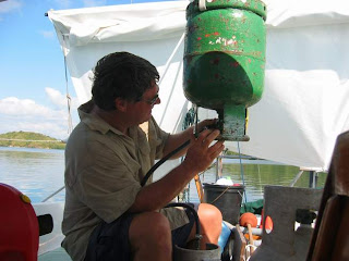 An example of one of the less romatic aspects of sailing, filling the propane tanks