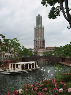 Canal with boat and Tower in the background