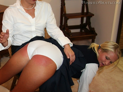 Spanked over her pretty pink panties