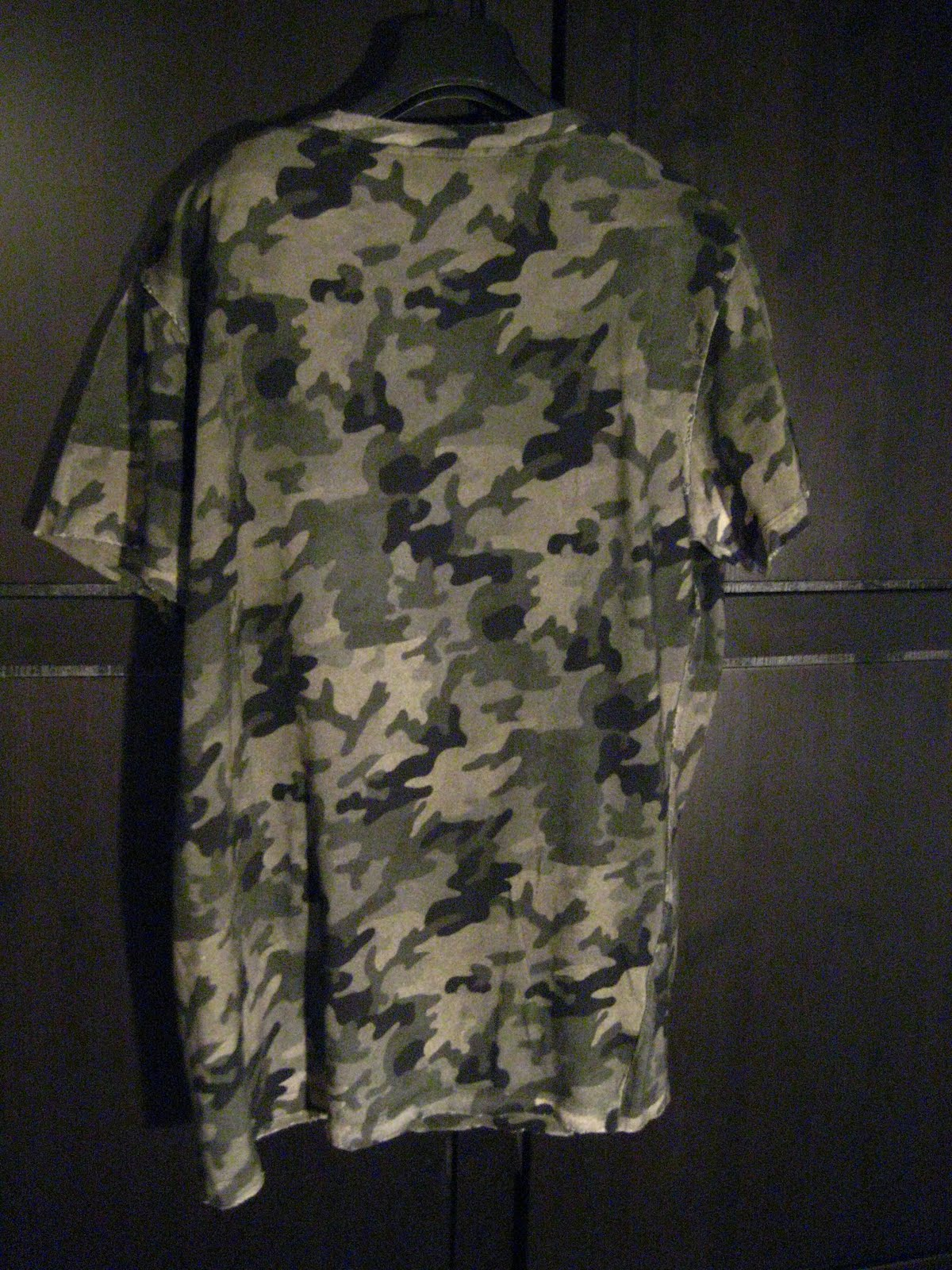 2678c02c BALMAIN HOMME over size tiger print t-shirt in khaki green camouflage base.  The t-shirt has the bullet ripped effect . Made in Italy