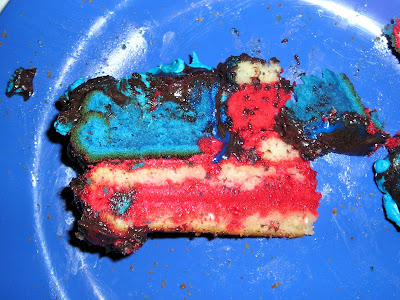 a slice of cake looks like the American flag, only more delicious