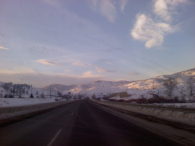 picture of highway and mountains, looking out of a car