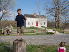 Kaleb standing on a log at the Smith house in Palmyra