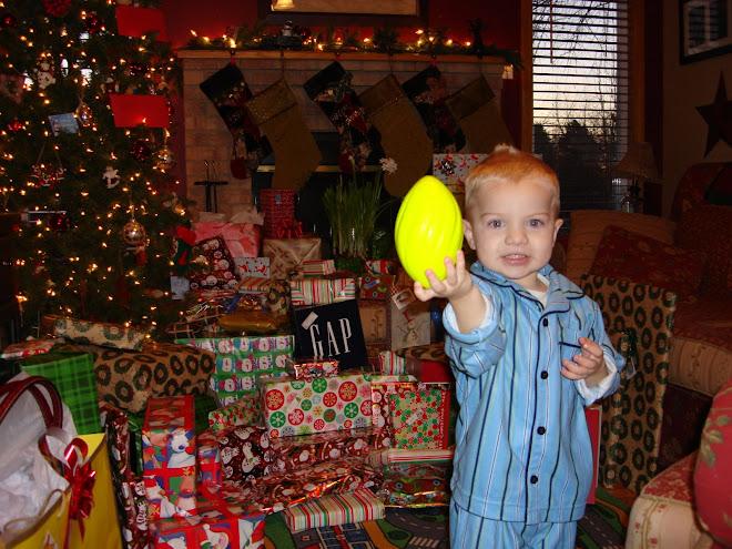Keaton and his football he got for Christmas