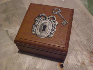 wooden box with lock and key