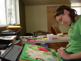 Angela Fehr painting raspberries in watercolor