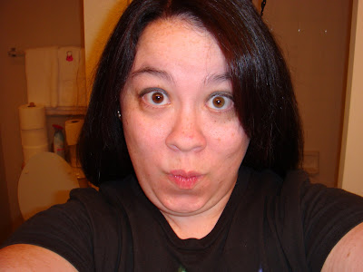 dark hair with pink highlights. the pink highlights a few blog entries lower than this one now does it?