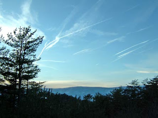 vapor trails over mountain