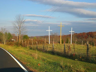 three crosses by road