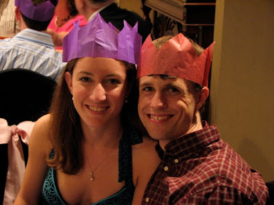 recently wedded couple wearing their crowns as well