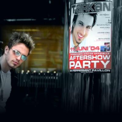 Tarkan's ex-backing singer Murat Boz standing beside a Tarkan poster