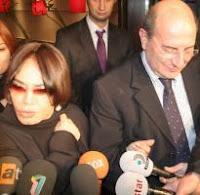 Aksu alongside Mustafa Oğuz, the father of the evening's birthday boy