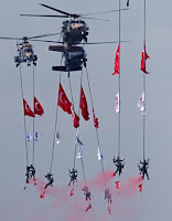 Members of Turkish army's Special Forces perform in the air during the celebration of the 84th anniversary of the Turkish republic in Ankara on October 29.