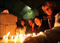 People lighting candles in Jordanian church