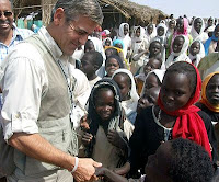 George Clooney describes being robbed at gunpoint while on a recent trip to Sudan with the United Nations