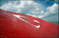 Workmen put the finishing touches on a giant Turkish flag painted on stones on a hillside in Kirikkale, Turkey, on Friday Oct 27